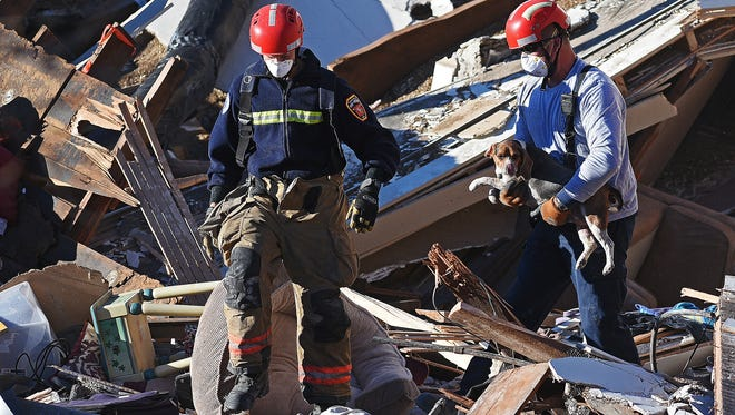 A third dog is rescued by Sioux Falls Fire Rescue at the site of the Copper Lounge building collapse Sunday, Dec. 4, 2016, in downtown Sioux Falls more than 48 hours after the collapse. One person was killed and another injured in the collapse. Two other dogs were also rescued from the scene.