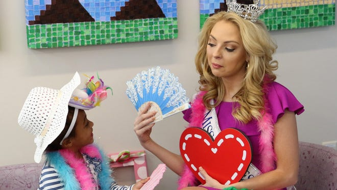 """This young lady enjoyed some """"special"""" time with Miss Tennessee Caty Davis during the second annual GenerosiTEA Party on March 3 at the Le Bonheur Children's Outpatient Clinic on Vann Drive in Jackson."""