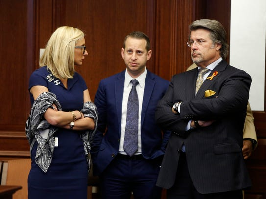"Rep. Jared Moskowitz, D-Coral Springs, center, is a Stoneman Douglas High School grad and called the bill a good ""first step."""