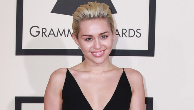 Recording artist Miley Cyrus attends The 57th Annual GRAMMY Awards at STAPLES Center in Los Angeles, California.
