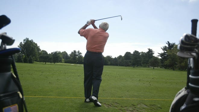 Arnold Palmer plays at the Turning Point Invitational at the Country Club of Detroit in Grosse Pointe Farms on Aug. 30, 2004.