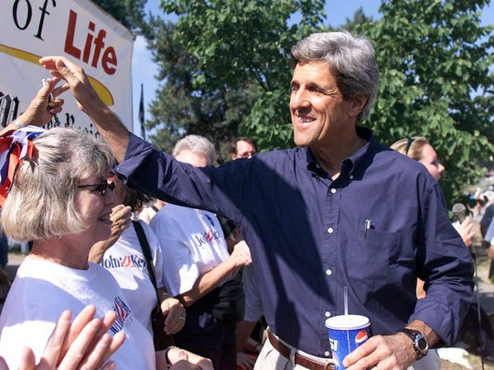 John Kerry works the crowd after his speech at the  Register's political soapbox at the 2003 Iowa State Fair.
