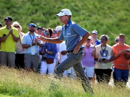 Wisconsin native Steve Stricker waves to the crowd as he prepares to tee off on hole No. 1  during round 3  of the 2017 U.S. Open Championship at Erin Hills.
