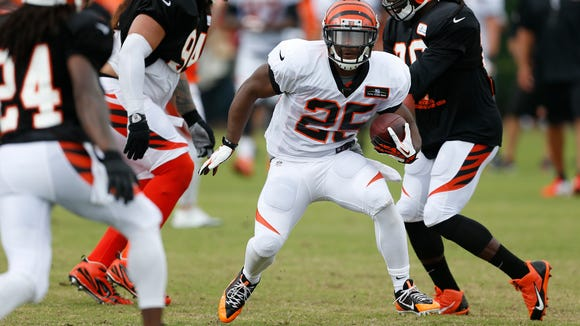 Bengals halfback Giovani Bernard runs the ball during training camp July 27.