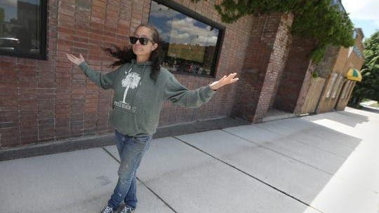 "Shelly Gonzales asks ""Why?"" as she stands on Marshall Street in Rochester Sunday, May 31, 2020. Shelly's daughter and son-in-law were attacked outside the Rochester Fire Equipment Company by a group of men Saturday during the riots that were happening in the city."