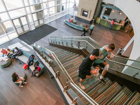 Anderson University students walk upstairs and sit in the G. Ross Anderson Jr. Student Center in Anderson. The 86,000-square-foot complex, includes space for dining, a banquet hall, a theater, a gym and a gathering spot for student fellowship and study.