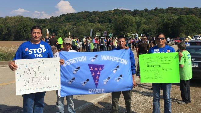 Members of the Sisseton Wahpeton Oyate tribe, whose reservation straddles the North Dakota-South Dakota border, rally in Pilot Mount, Iowa, Sept. 22, 2016, against the Dakota Access pipeline.