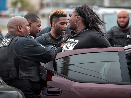 Ashley Cathey is arrested as protesters with Coalition