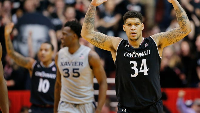 Cincinnati Bearcats guard Jarron Cumberland (34) pumps up the crowd in the second half during the 84th annual Skyline Chili Crosstown Shootout basketball game between the Xavier Musketeers and the Cincinnati Bearcats, Thursday, Jan. 26, 2017, at Fifth Third Arena in Cincinnati.