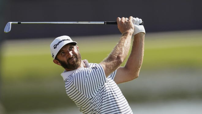 Dustin Johnson hits from the fairway on the 8th hole during the third round of the Tour Championship golf tournament at East Lake Golf Club in Atlanta, Sunday, Sept. 6, 2020.