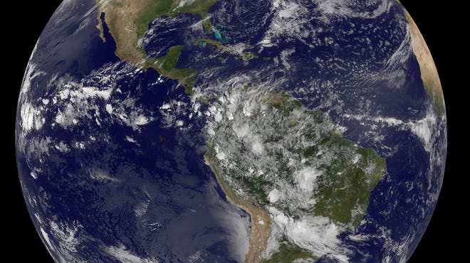 A satellite image shows Earth with a view of the Americas.