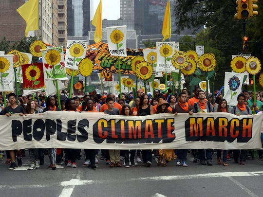 Marches make their way across Central Park South during the People's Climate March on Sunday, Sept. 21 in New York. Activists mobilized in cities across the globe Sunday for marches against climate change.