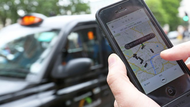 The ride-sharing app Uber allows people to find a ride in a car using their phone. A Cincinnati-area Uber driver said he was physically attacked and racially abused by a rider, according to a release from the Council on American-Islamic Relations.