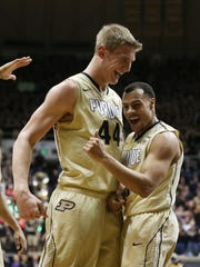 Purdue Boilermakers center Isaac Haas and teammate Bryson Scott celebrate a big lead over Indiana in the first half. Purdue hosted Indiana at Mackey Arena Wednesday, January 28, 2015.