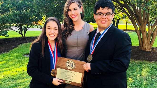Central High School junior Andrea Meador-Safont and senior Alfredo Antu pose for a photo with Speech and Debate coach Julie Schniers.