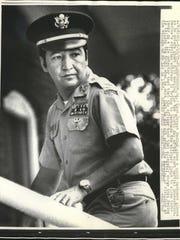 Former U.S. Army Capt. Ernest Medina gives a quick