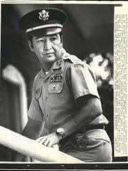Former U.S. Army Capt. Ernest Medina gives a quick backward glance as he enters court in 1971 for the fourth day of his court martial proceedings related to the My Lai massacre.