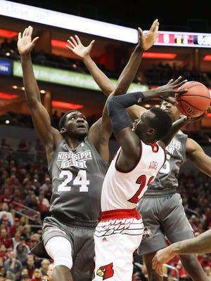 U of L's Deng Adel (22) adjusted his shot against Mississippi State's Abdul Ado (24) during the NIT at the Yum Center in Louisville.    