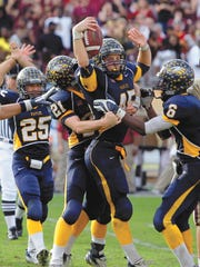 Naples linebacker Kyle Lindquist (45) is lifted in the air by teammates after making the game-clinching interception during the fourth quarter in the Class 3A state championship game against St. Augustine at the Citrus Bowl in Orlando on Dec. 14, 2007.