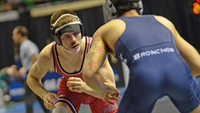 St. Cloud State 125-pounder Brett Velasquez competes against Joshua Lindsey of Central Oklahoma in the first round of the NCAA Division II national champonships Friday in Birmingham, Ala. Velaquez won, 23-2.