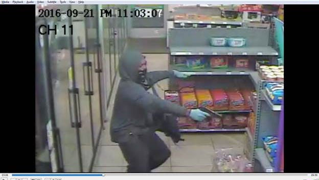 Police are looking for this masked gunman they say attempted to rob M Market on Thompson Lane Sept. 22, 2016.