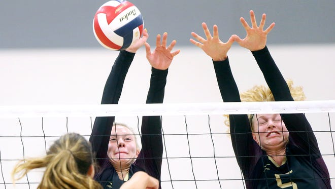 Tuloso-Midway's Kelsi Luckenbach (left) and Bethany Clapp reach for the ball against London during the CCISD McDonald's SpikeFest Championship game on Saturday, Aug. 12, 2017, at Veterans Memorial High School in Corpus Christi.
