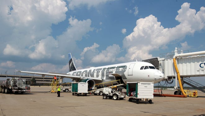 A Frontier Airlines A320 Airbus is serviced after landing at Cincinnati/Northern Kentucky International Airport.