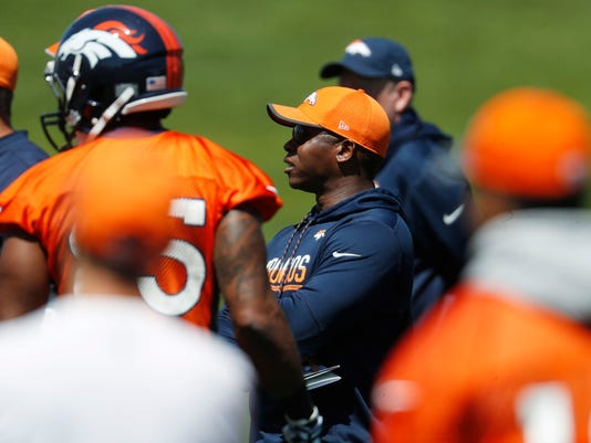 Denver Broncos head coach Vance Joseph, center, looks on as players take part in drills during an NFL football minicamp session at the team's headquarters Tuesday, May 30, 2017, in Englewood, Colo. (AP Photo/David Zalubowski)
