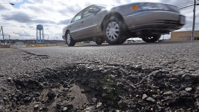 A pothole on Lexington-Springmill Road in Ontario this spring.