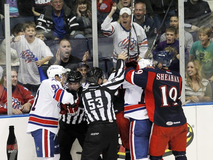 Rochester's Frederick Roy, left, gets the crowd going, both on the ice and in the crowd, with his antics after a whistle during AHL hockey action in the season opener between the Grand Rapid Griffins and the Rochester Americans at the Blue Cross Arena on Oct. 4, 2013.