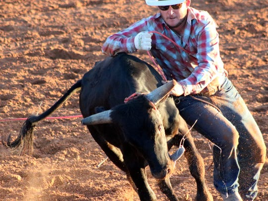 File photo of a cowboy attempted to wrestle down a steer during the Otero County Fair Ranch Rodeo in 2017.