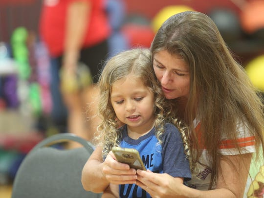 Moms and their babies gathered Friday at the Wellness
