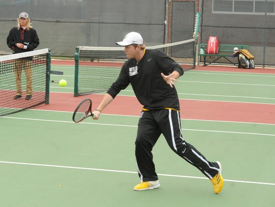 Wylie's Cole Edwards goes to the net at No. 4 singles