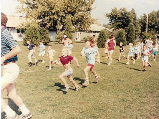 "Pictured are Shane Smith and his brother, Shannon, participating in the 1988 ""It's Fun to Run."""
