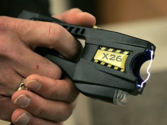 A stun gun is seen in this Associated Press photo