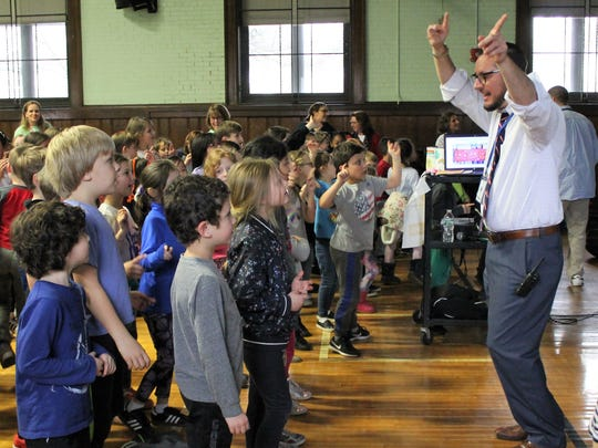 McKinley School principal Marc Biunno leads students and staff in a preliminary dance as the school kicks off its annual fundraising effort for pediatric cancer research.