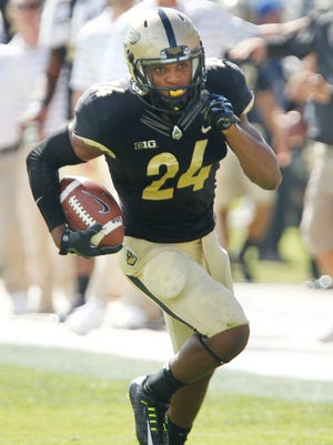 Frankie Williams returns an interceptiong for a touchdown against Iowa at 4:13 in the first quarter Saturday, September 27, 2014, at Ross-Ade Stadium. Iowa defeated the Boilermakers 24-10.
