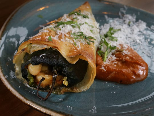 Chili relleno at Livery is stuffed with farro, white