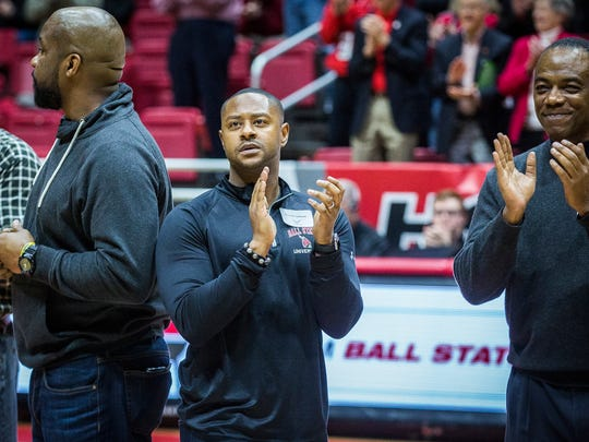 Former Ball State basketball player Patrick Jackson joins other former players for a ceremony during half time of Ball State's game against Western Michigan Saturday, Jan. 28, 2017.