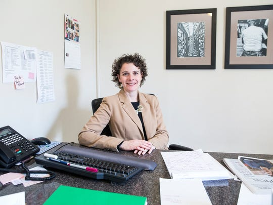 Lindsey Arthur of Habitat for Humanity in her office.