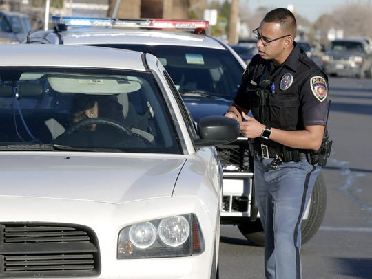 EPISD police Officer Raul Ramos talks to a driver after