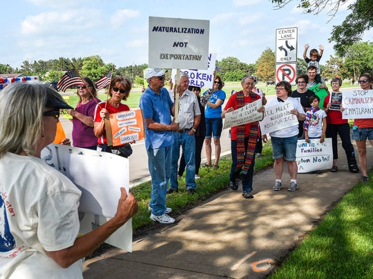 Demonstrators from Indivisible MN03 and Indivisible North Metro held signs in protest of Immigration Customs Enforcement (ICE) detaining of immigrants Wednesday, June 27, outside the Sherburne County Government Center.