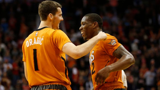 Phoenix Suns guards Goran Dragic and Eric Bledsoe take a break during the final seconds of their 99-93 win against the Chicago Bulls at US Airways Center in Phoenix on Jan. 30, 2015.