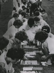 Young chess players figure out their moves during the
