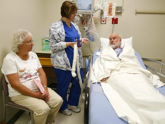 Don Samuelson, right, listens to anaesthesia R.N. Tracy Pryor before going in for a new advanced knee replacement surgery with a much shorter healing time at JFK Memorial Hospital in Indio. At left is his his wife Jolynn Samuelson.
