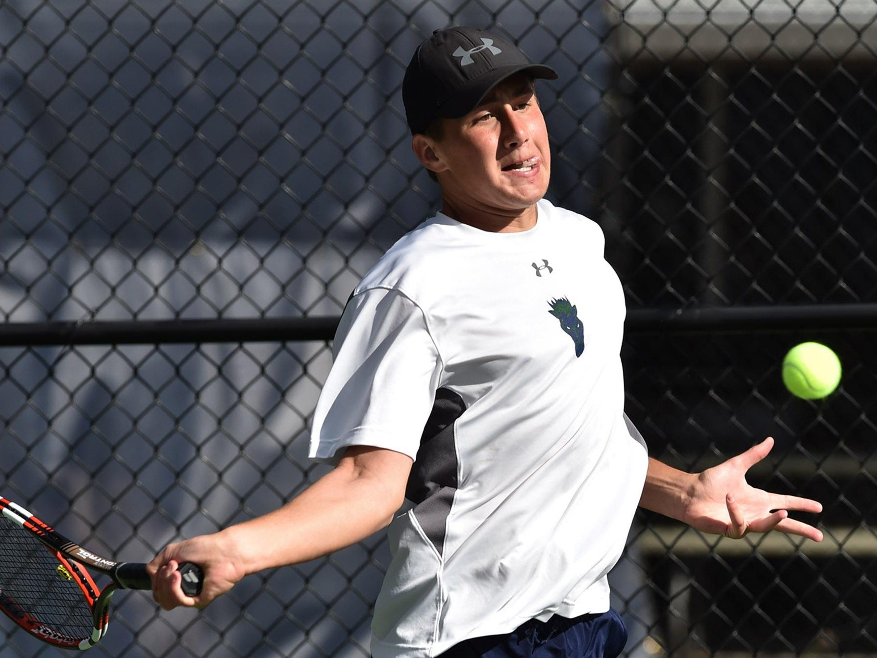 Damonte Ranch's Tim Zagar winds up to hit a forehand to opponent Natale Castelli, also of Damonte Ranch, during the Northern Region boys singles final at the Caughlin Athletic Club on Monday.