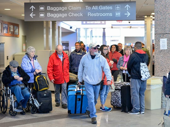 Passengers bustle about the St. Cloud Regional Airport in this 2014 file photo.