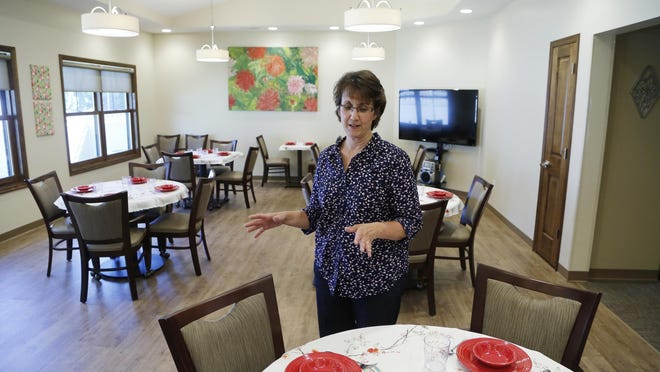 Cathy Benner discusses the color selection for items in the dinning room at Joyful Journey Wednesday, July 22, 2015, at the corner of Salisbury Street and Lindberg Road in West Lafayette. Benner said red plates and bowls were specifically selected as the color stimulates interest and can increase food consumption. The dinning room can also be used for other activities, such as crafts. The adult day service is for elderly and disabled people who can't stay home alone. Benner is co-founder of Joyful Journey with her husband Gerard Benner.