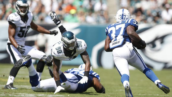 Eagles linebacker Marcus Smith (90) is taken down as he pursues Colts running back Zurlon Tipton in the second quarter Sunday.
