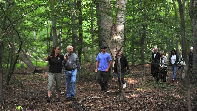 Great Swamp Watershed Association director of land stewardship Hazel England leads a walk on the Horizon Trail.